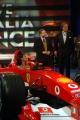 Maria Grazia Cucinotta seduta dentro all Ferrari  F 2003 GA nella trasmissione  porta a porta con Jean Todt e Montezemolo