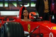 Maria Grazia Cucinotta seduta dentro all Ferrari  F 2003 GA nella trasmissione  porta a porta