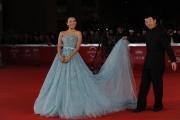 Foto/IPP/Gioia Botteghi 02/11/2011 festival del cinema di Roma, red carpet Love for life, nella foto: Zhang Ziyi con il regista Gu che sostiene l'abito di Dior